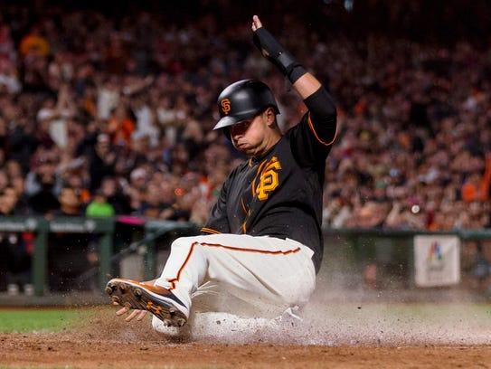 San Francisco Giants second baseman Joe Panik slides