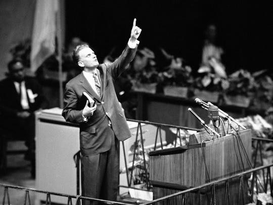 Evangelist Billy Graham is shown speaking at Madison