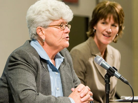 The WNBA Indiana Fever named Lin Dunn, left, head coach December 12, 2007. Listening to Dunn speak in this photo is  Chief Operating Officer and General Manager Kelly Krauskopf, right.