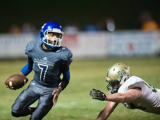 Harriman's Kylann Love looks for an open receiver while