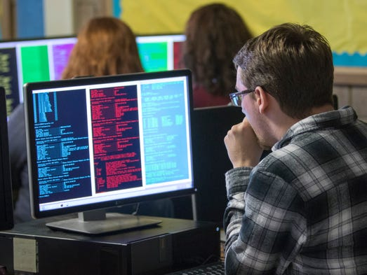 Joseph Ivey, 18, concentrates on his computer monitor