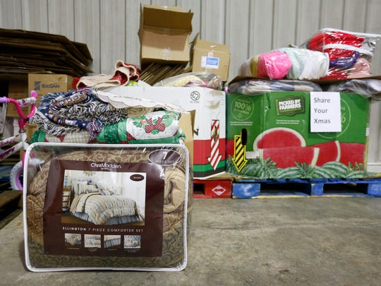 Assorted bedding, winter cloths, housewares and toys wait to be sorted at Crosslines for the Share Your Christmas program.