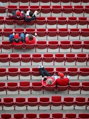 Fans take their seats before the MLB Opening Day game between the Cincinnati Reds and the Philadelphia Phillies at Great American Ball Park in downtown Cincinnati on Monday, April 3, 2017.