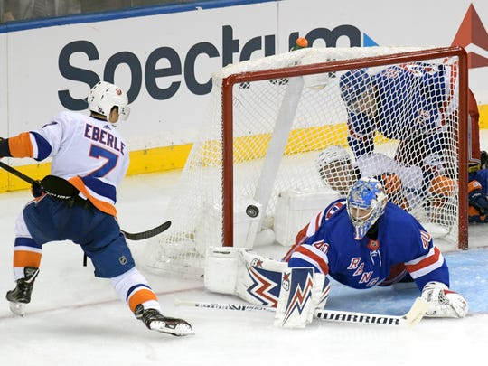 New York Rangers goaltender Alexandar Georgiev (40) makes a sad on a shot by New York Islanders right wing Jordan Eberle (7) during the third period of an NHL preseason hockey game Tuesday, Sept. 24, 2019, at Madison Square Garden in New York. (AP Photo/ Bill Kostroun)