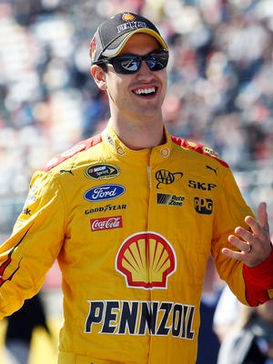 Joey Logano leads the Chase for the Sprint Cup standings after winning at Charlotte.