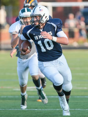 Bridgewater-Raritan quarterback Eric Nickel (10) carries for the Devil Dogs at Basilone Bowl IV, a charity all-star football between graduated seniors to benefit the U.S. Marine Corps, at Somerville High School on June 30, 2016.