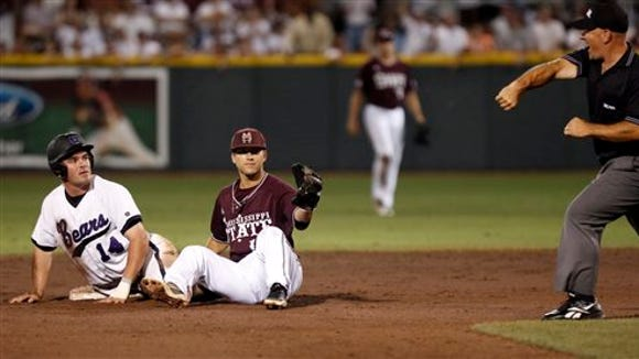 Mississippi State's Brett Pirtle, center, holds up his glove with the ball as the umpire gestures that Central Arkansas' Garrett Brown (14) is out at second base in their NCAA college baseball regional tournament game in Starkville, Miss., Sunday June 2, 2013. The two teams play Monday to determine the regional champion. (AP Photo/Rogelio V. Solis)