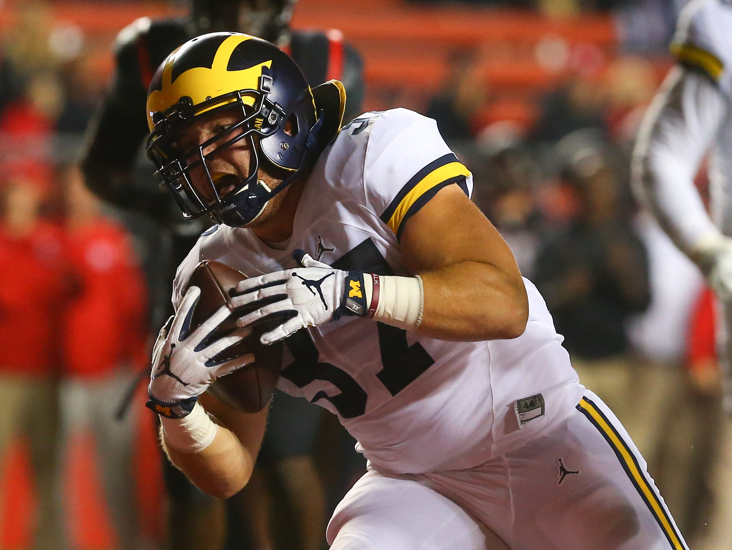 Michigan Wolverines fullback Bobby Henderson, a John Jay High School graduate, runs for a touchdown against the Rutgers Scarlet Knights at High Points Solutions Stadium on Oct. 8 in Piscataway, New Jersey.