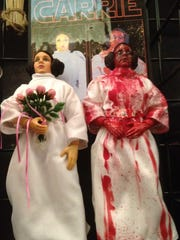 Horror movie memorabilia for sale at last year's Days of the Dead convention included these 'Star Wars' Princess Leia dolls decorated to resemble a scene from 1976's 'Carrie.'