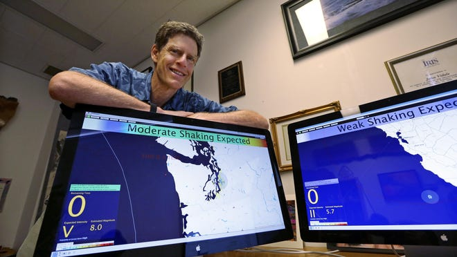 Above: John Vidale, director of the Pacific Northwest Seismic Network at the University of Washington, displays a beta version of an early warning system for earthquakes on Aug. 6 in Seattle. Top: Various bridges in Portland span the Willamette, and they vary in age and ability to withstand a major earthquake.