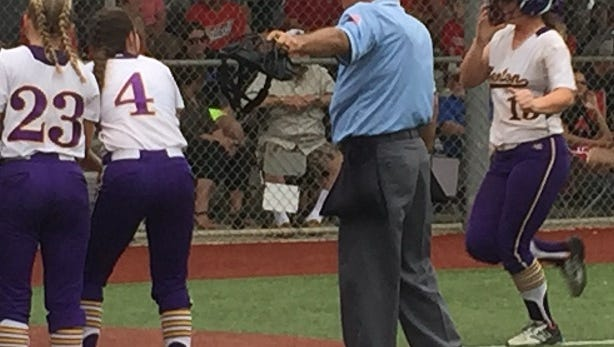 Benton's Sarah Koeppen heads for home after hitting her second home run of the day against Belle Chasse.