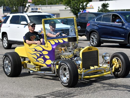 A custom Ford hot rod sports a bright paint job during