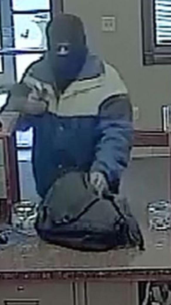 Surveillance footage shows the robber at Dacotah Bank,