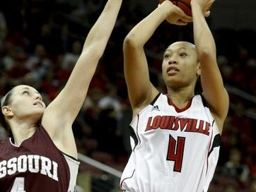 U of L's Antonita Slaughter, shoots over Missouri State's Kenzie Williams, during their game at the KFC Yum! Center. She was later removed by a stretcher after she collapsed from an apparent seizure. Sam Upshaw Jr., The Courier-Journal