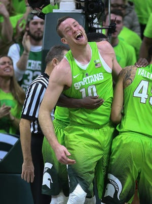 Michigan State's Matt Costello celebrates with teammates after blocking  a shot during the final seconds of the 74-65 win over Maryland on Saturday at the Breslin Center.