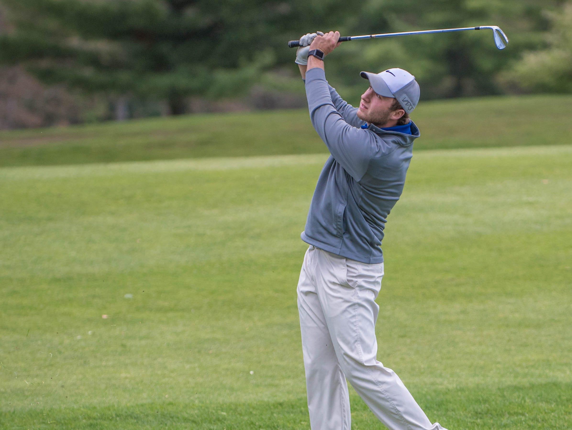 Harper Creek junior Alex Johnson hits his fairway shot during All-City Golf Tournament at Riverside Golf Club on Friday.