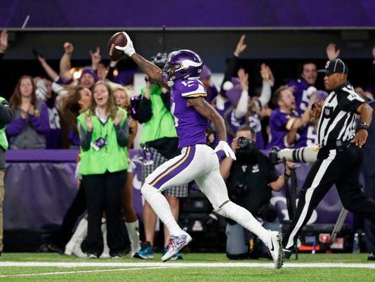 FILE - In this Sunday, Jan. 14, 2018, file photo, Minnesota Vikings wide receiver Stefon Diggs (14) runs in for a game winning touchdown against the New Orleans Saints during the second half of an NFL divisional football playoff game in Minneapolis. Diggs has had his ups and downs throughout his life and career, but there's been no greater high on the field than his 61-yard touchdown reception on the final play for Minnesota to beat New Orleans and advance in the playoffs. (AP Photo/Jeff Roberson, File)