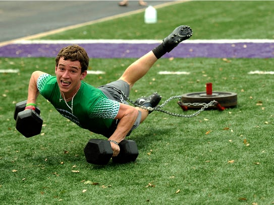 Jared Woods, from Hamlin, dives across the line to