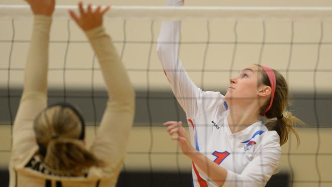 Union County's Allison Kassens hits against Winchester's Riley Study Thursday, Oct. 22, 2015 during sectional volleyball in Winchester.