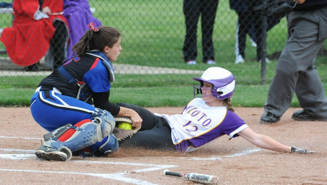 Unioto's Jayla Campbell slides into a tag from Zane Trace's Morgan Arledge Wednesday night at Unioto High School. Campbell was called safe and the Shermans beat the Pioneers 4-3.