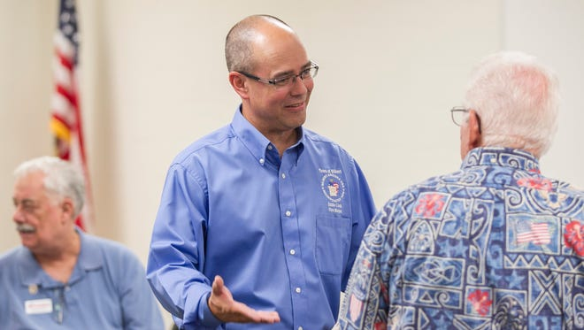 Eddie Cook, a candidate for Gilbert Town Council, speaks with other republicans at a meeting of LD 12 Republicans in Mesa, AZ on Thursday, July 10, 2014.