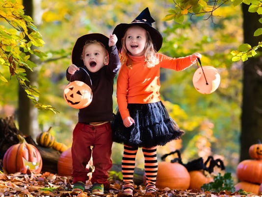 Beautiful kids with pumpkins on Halloween