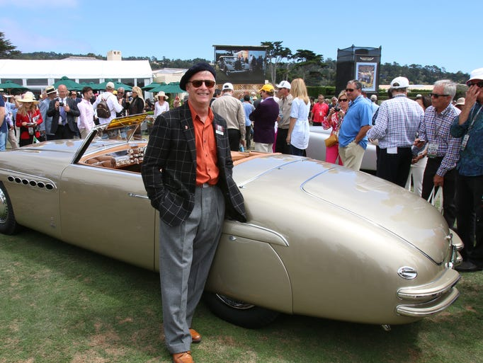 Chris Ohrstrom, from The Plains, Va., with his Alfa Romeo at the Pebble Beach Concours d'Elegance in Pebble Beach. Calif.
