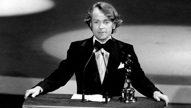John Avildsen accepts the Oscar for best director for 'Rocky' at the Academy Awards in Los Angeles on March 28, 1977.