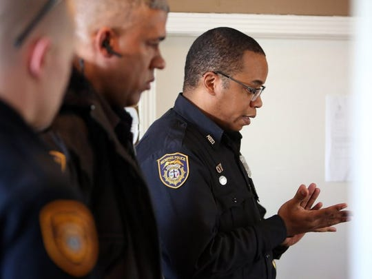 February 26, 2016 - Officer Ross (right) chats with a complainant while on a recent call. With Ross are officers Gregory Marlar (left) and Donovan Tabler. (Stan Carroll/The Commercial Appeal)