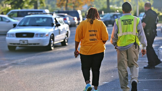 Mothers Against Violence and the Indianapolis Ten Point Coalition arrive at a crime scene on the city's northwest side,on Sept. 21, 2016. The City-County Council has approved a proposal to award $400,000 to groups that patrol neighborhoods.