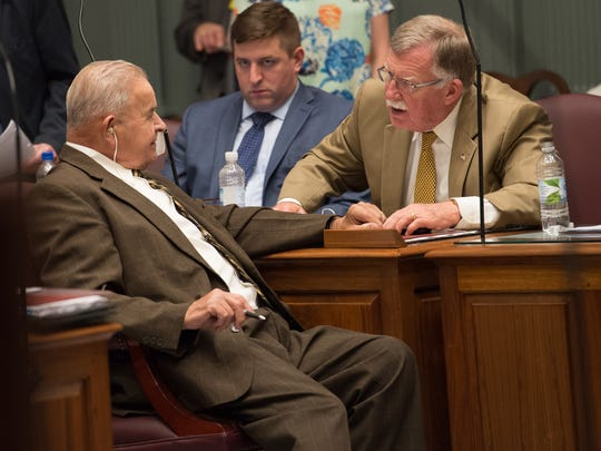Bruce C. Ennis, D-Smyrna, and Brian J. Bushweller, D-Dover/Central Kent, have a quick conversation during a session in the Senate chamber at Legislative Hall in Dover.