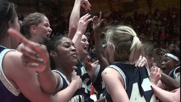 Notre Dame's Niele Ivey (33), Kari Hutchinson (42) and Meaghan Leahy (44) celebrate with other teammates after beating Texas Tech 74-59 in the NCAA women's regionals second round game in Lubbock, Texas March 15, 1998.