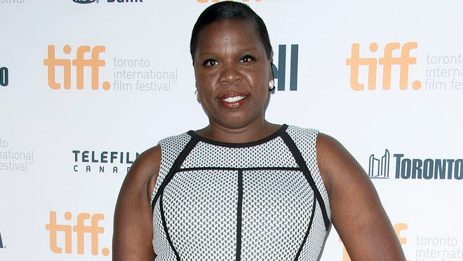"Actress Leslie Jones poses Sept. 6 at the ""Top Five"" premiere at the Princess of Wales Theatre during the 2014 Toronto International Film Festival in Toronto. NBC says ""Saturday Night Live"" is adding Jones to its cast. She wins her on-camera role after serving as a writer on the show last season."