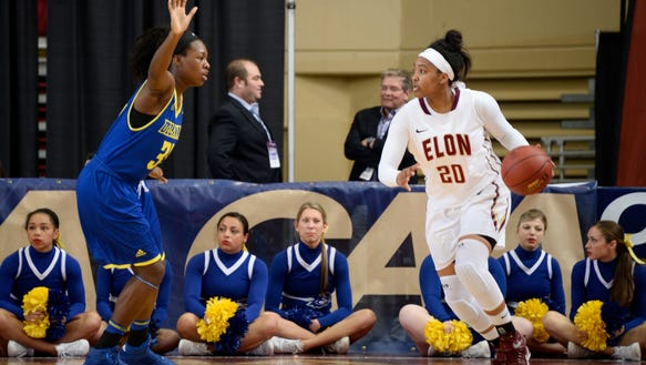 Nikki McDonald, right, is transferring from Elon to