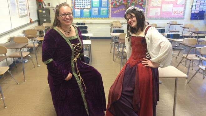 Triton High School teachers Michelle Cohen (left) and Cathy Stelling dress the part for Shakespeare's birthday at Triton High School.