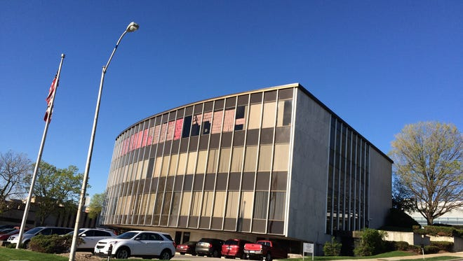 """ISEA officials have plastered """"pink slips"""" across the windows of their office overlooking 2nd Avenue in Des Moines to protest a delay in setting school funding."""