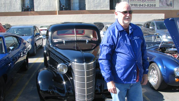 Gene Winings of San Clemente, Calif., shows off his