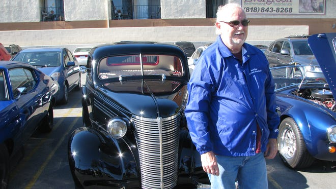 Gene Winings of San Clemente, Calif., shows off his 1938 Chevrolet hot rod at a car show in Burbank, Calif.