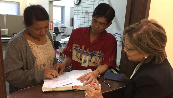 Sen. Nerissa Bretania Underwood, right, submits her bill to amend Guam's marriage law to remove references to gender at the Guam Legislature on June 5.