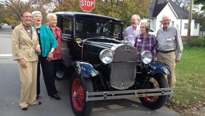Kathleen Mayo Duke, Ernestine Baird, Betty Stubblefield, Robert Dishner, Loretta Dishner and John Ackerman stand with Dishner's 1931 Ford Model A.