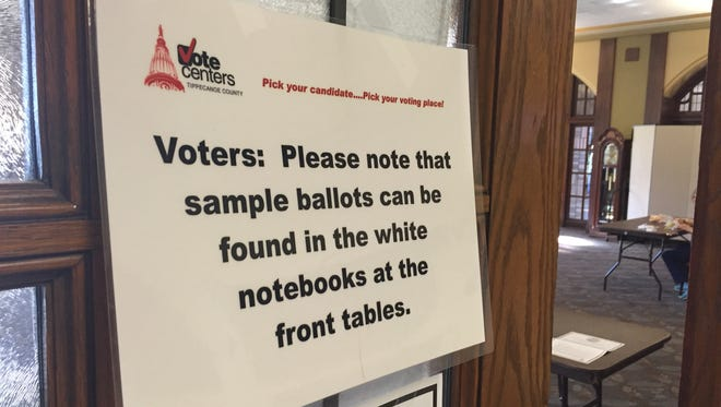 A sign outside the polls at the Purdue Memorial Union encouraged voters to ask for a sample ballot before voting.