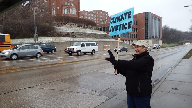 Miriam Kashia of the advocacy group 100 Grannies for a Livable Future demonstrates for climate change awareness on Riverside Drive.