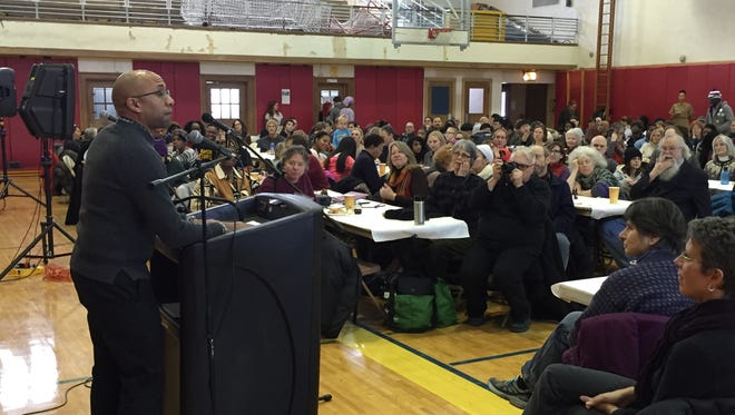 Cornell University history professor Russell Rickford speaks to about 350 people at the Martin Luther King Jr. Day luncheon at Beverly J. Martin Elementary in Ithaca.