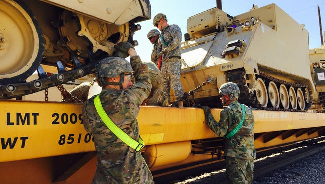 Soldiers from Fort Bliss' 3rd Brigade were busy last week getting vehicles and equipment onto rail cars for the trip to Fort Irwin, Calif.