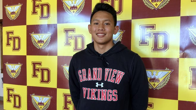 In this file photo, Father Duenas' Eric Ada is shown after signing  his letter of intent to play for the Grand View Vikings. Ada was named MVP and first-team All-Island for the 2016 IIAAG Boys' Volleyball League.