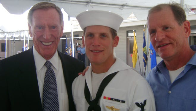 Navy SEAL Charlie Keating died in northern Iraq on Tuesday. He is seen at his Navy SEAL graduation in 2008 with his grandfather Charles Keating Jr. (left) and his father, Charles Keating III.