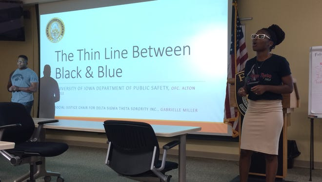 Gabrielle Miller speaks before a discussion with the University of Iowa Police Department on racial bias, policing and citizens' rights Wednesday night.