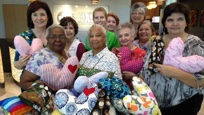 Members of the Peace by Piece Quilt Guild presented 340 pillows to the Kirkland Cancer Center.
