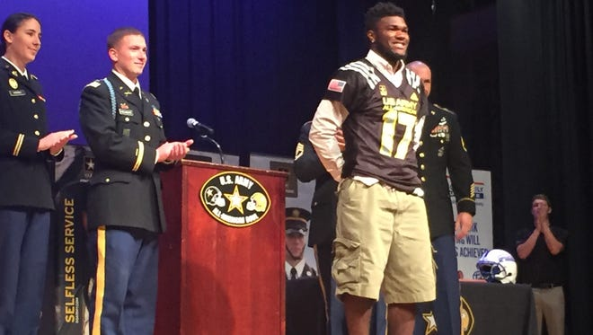 Clinton's Cam Akers was presented with his U.S. Army Bowl jersey.