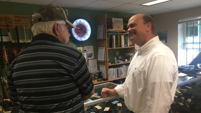 U.S. Rep Tom Reed, R-Corning, right, discusses Second Amendment rights with retired Corning Police Chief Richard Faulisi during a campaign stop at Bullseye Shooter's Supply in Gang Mills.